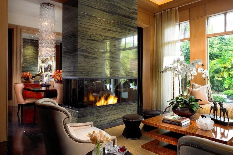 Asian mid-century luxury living room with fire place, chandelier and orchid