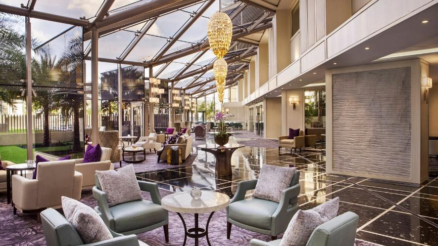 miami luxury interior design hotel lobby with chandeliers