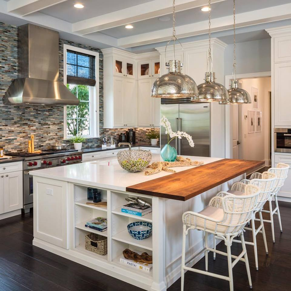 luxury kitchen with hammered metal pendant lamps with open shelves