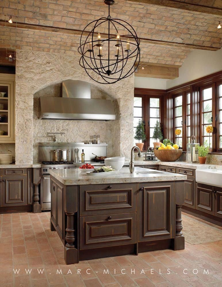 luxury rustic kitchen with square island and ornate chandelier