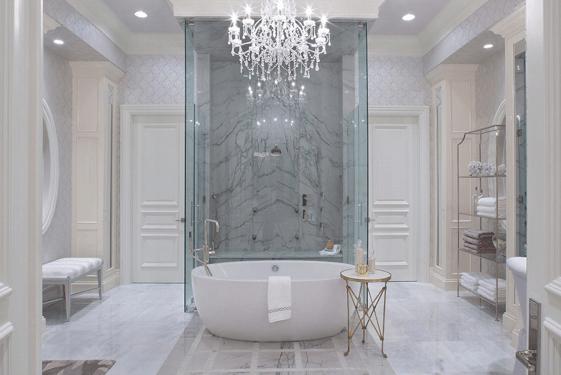 Luxury bathroom with smart lighting chandelier over a bathtub.