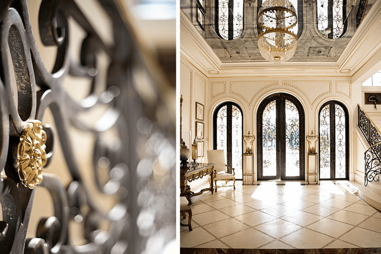 Luxury hotel lobby with 3 glass doors and a chandelier.