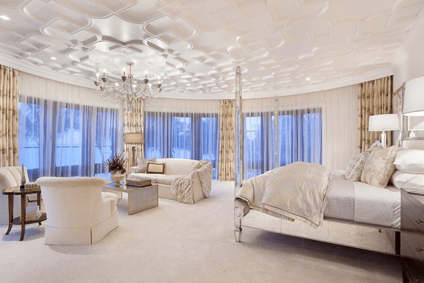 An elegant luxury hotel room with a silver chandelier.