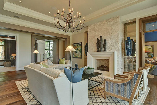 Transitional Design living room with a fireplace and chandelier.