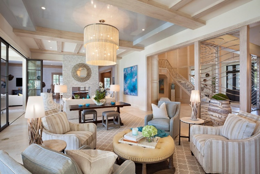 Tropical Georgian-stle disned gulf stream living room with a chandelier.