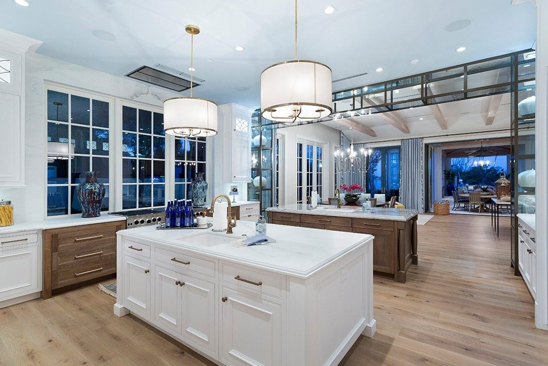 A luxurious kitchen with an open format and an island.