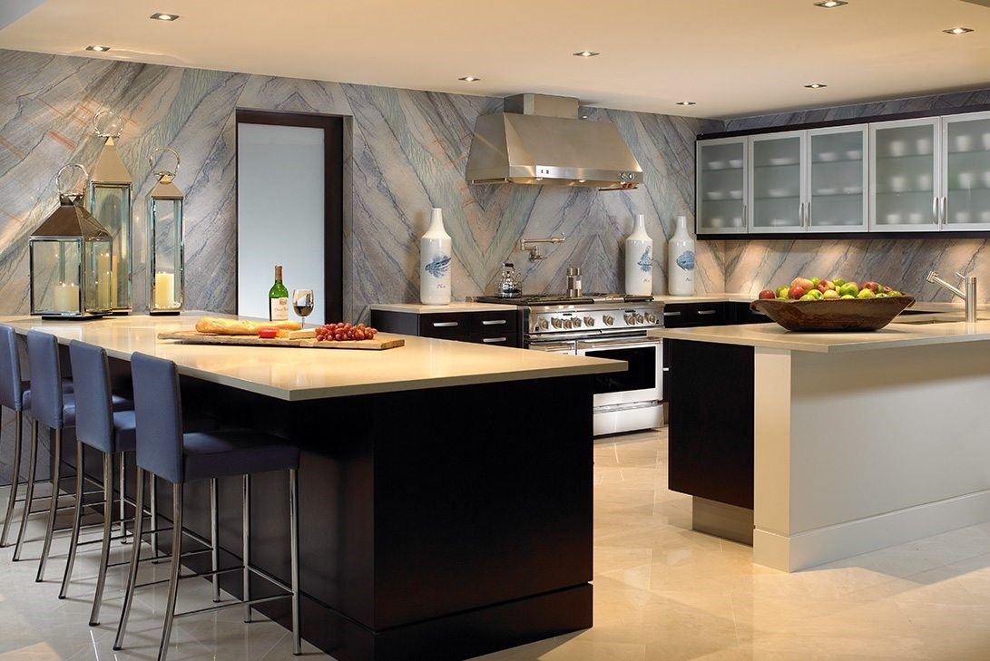 Modern luxury kitchen with a multifunctional island and seating.
