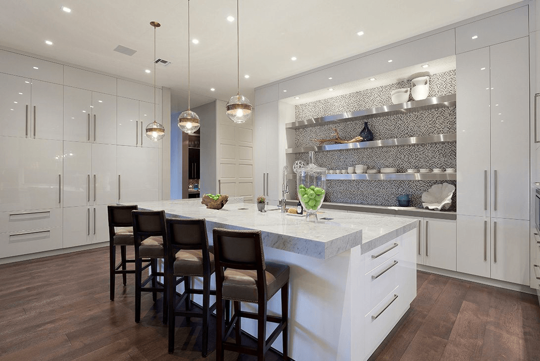 Modern Georgian designed kitchen with vibrant green apples accenting the features..