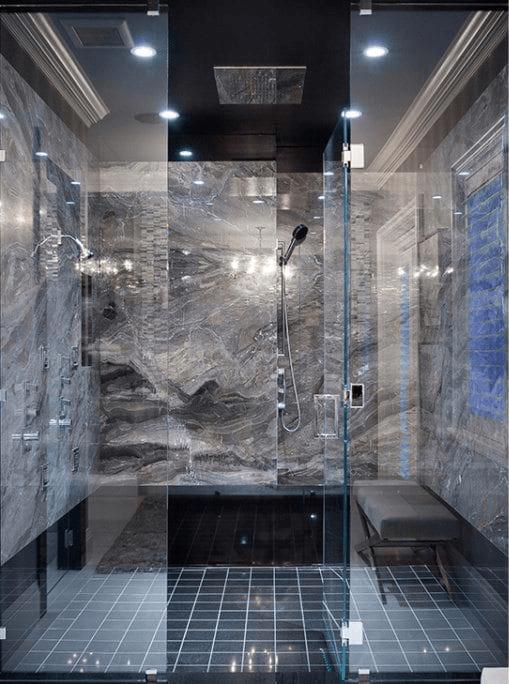 European-inspired estate luxury bathroom with multiple shower heads.
