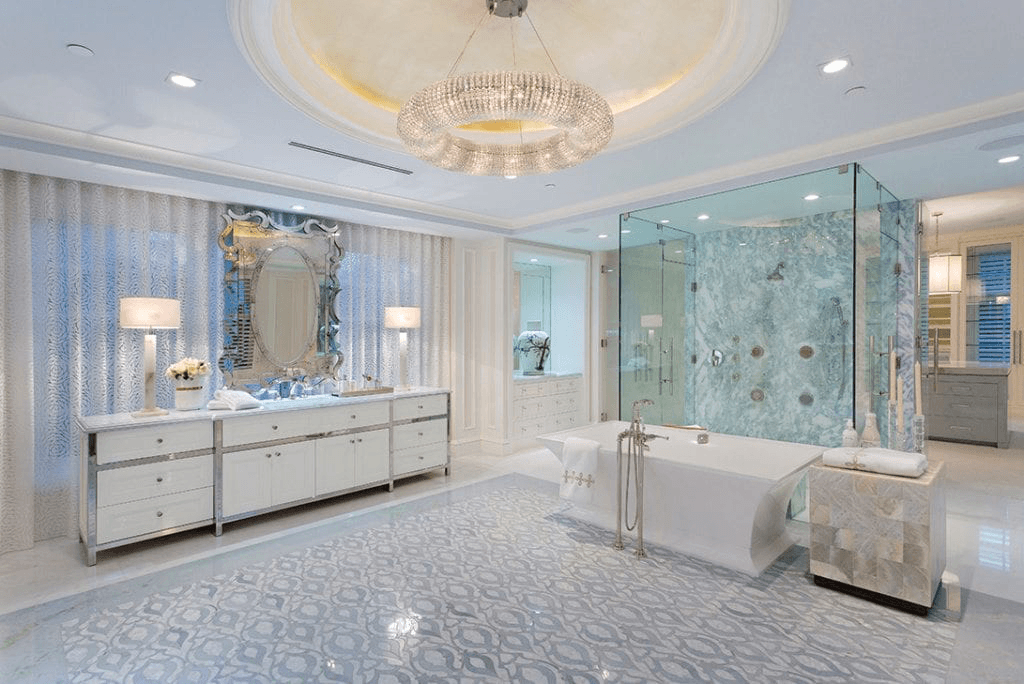 Our Lakefront Palm Beach home's luxury bathroom, with a marble shower, crystal chandelier, and one-of-a-kind tile floor.