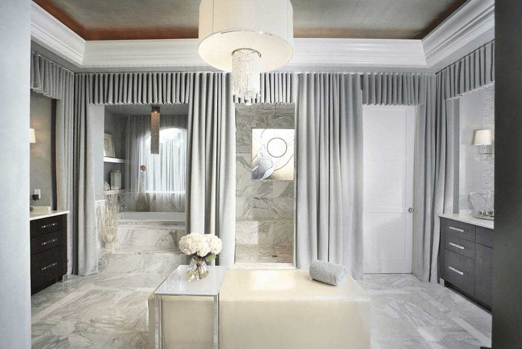 Our Organic Boca Raton project luxury bathroom, with cascading curtains, a private soaking tub, and soft lighting.