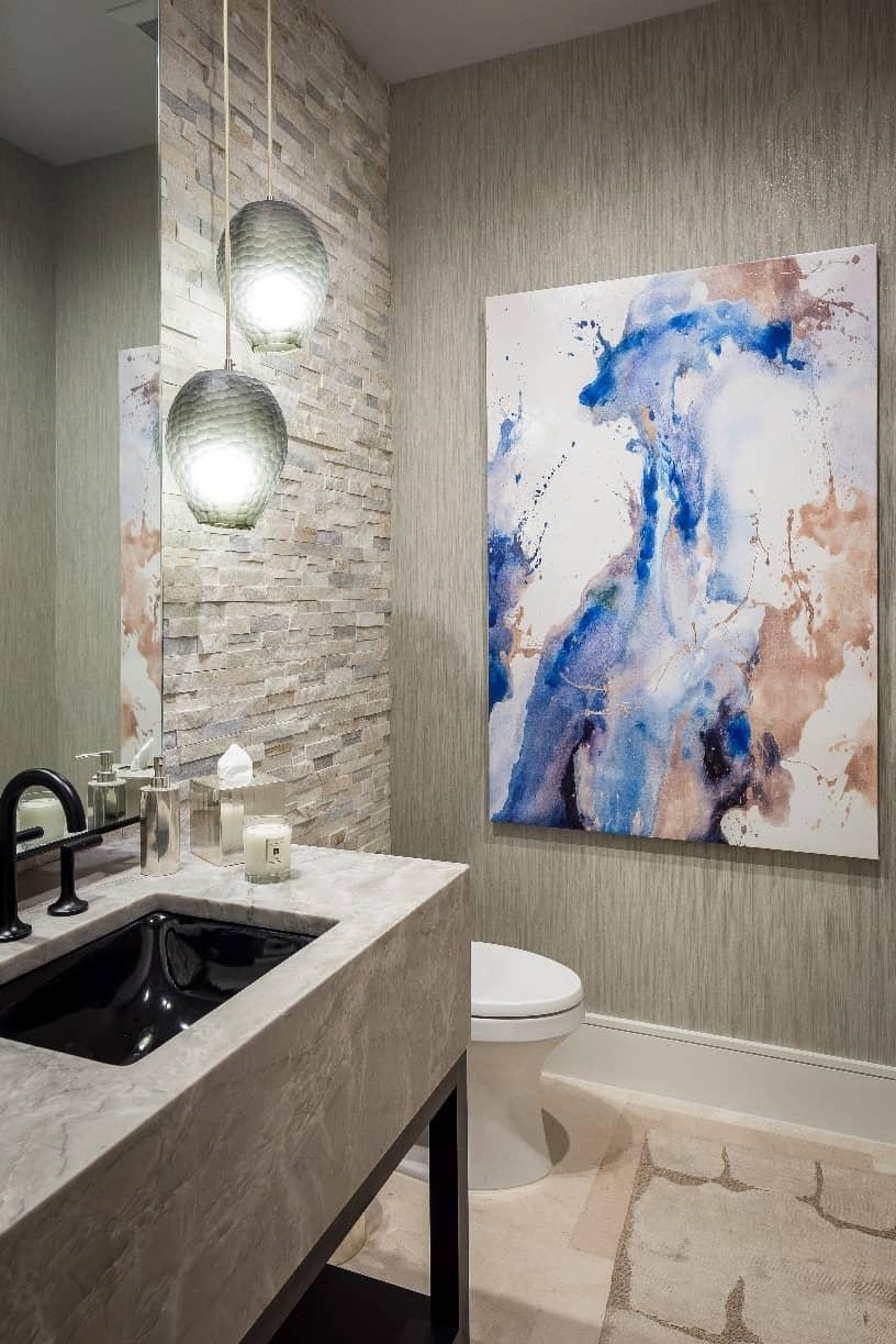 Luxury bathroom with stacked stone tiles.